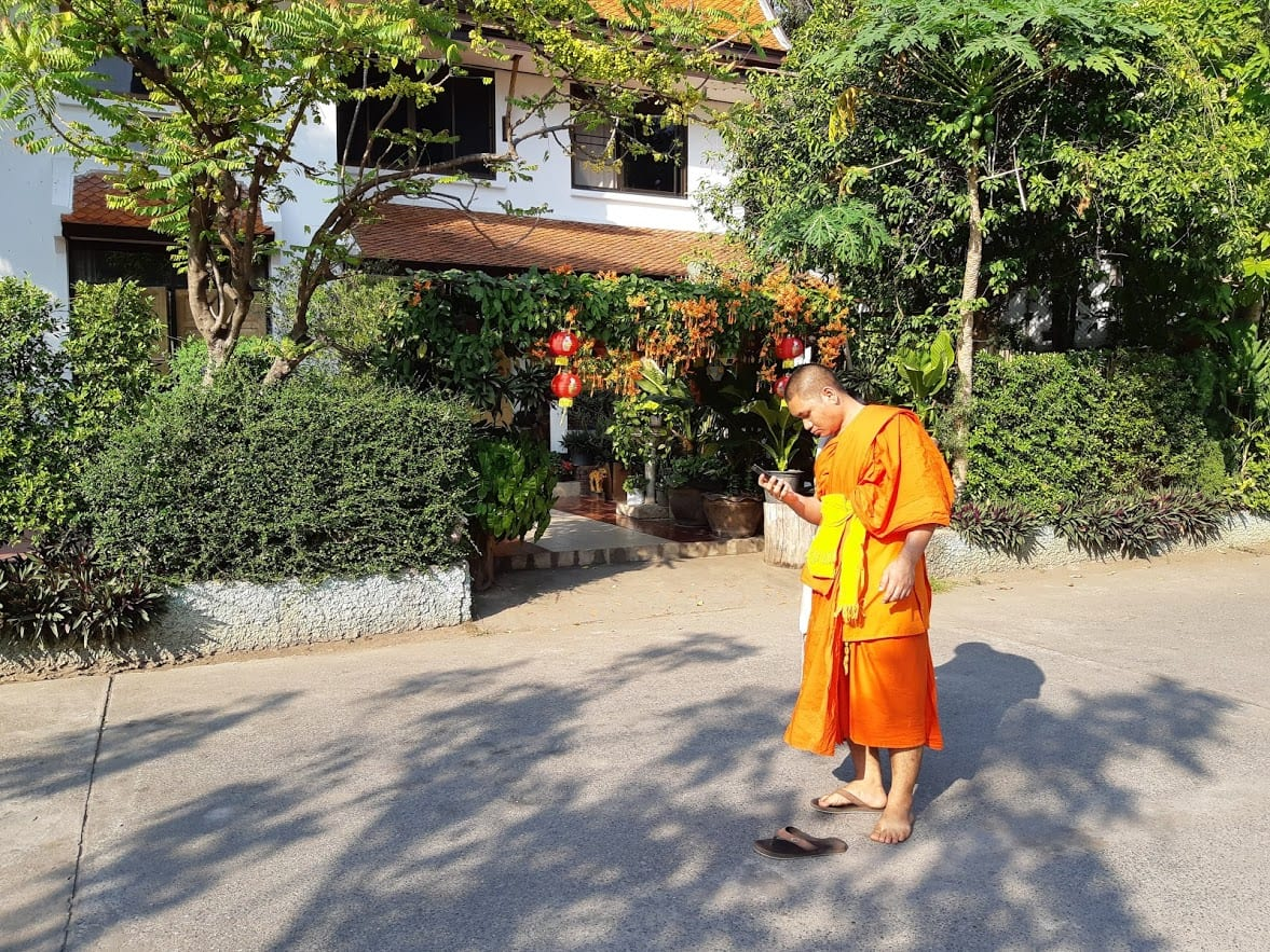 Buddhist monk on mobile phone
