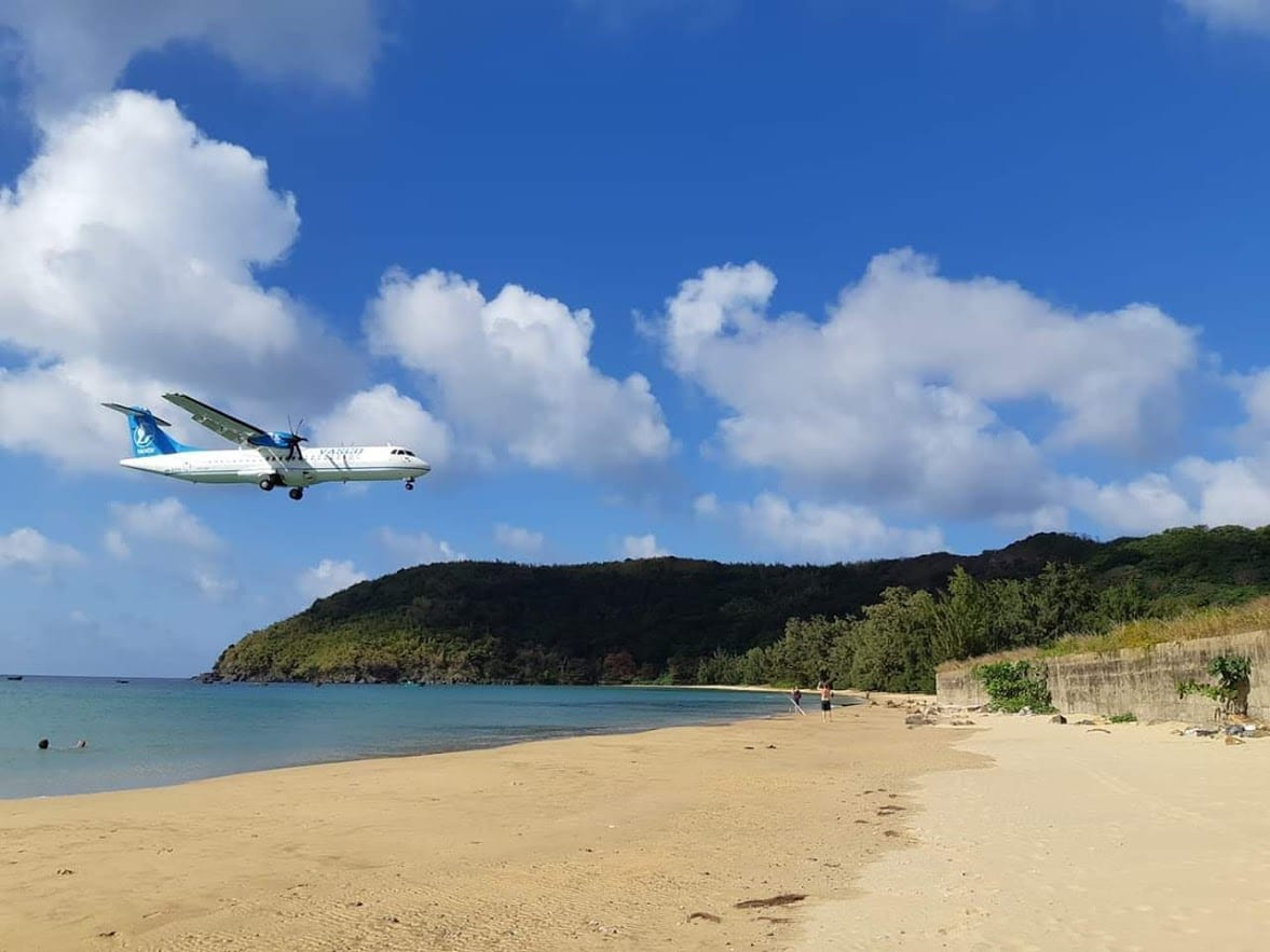 Plane landing over the beach at Con Dao island in Vietnam