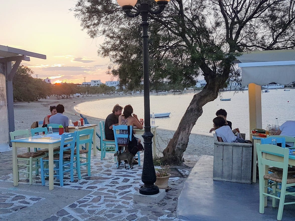 A sunset meal by the sea in Pollonia Milos Greece