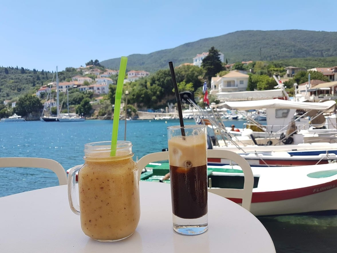 Relaxing with some cool drinks by a bay in Ithaka Greece