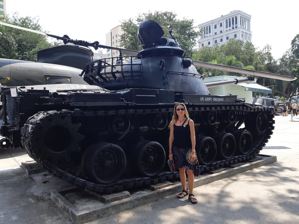 Vanessa in front of a tank in Saigon