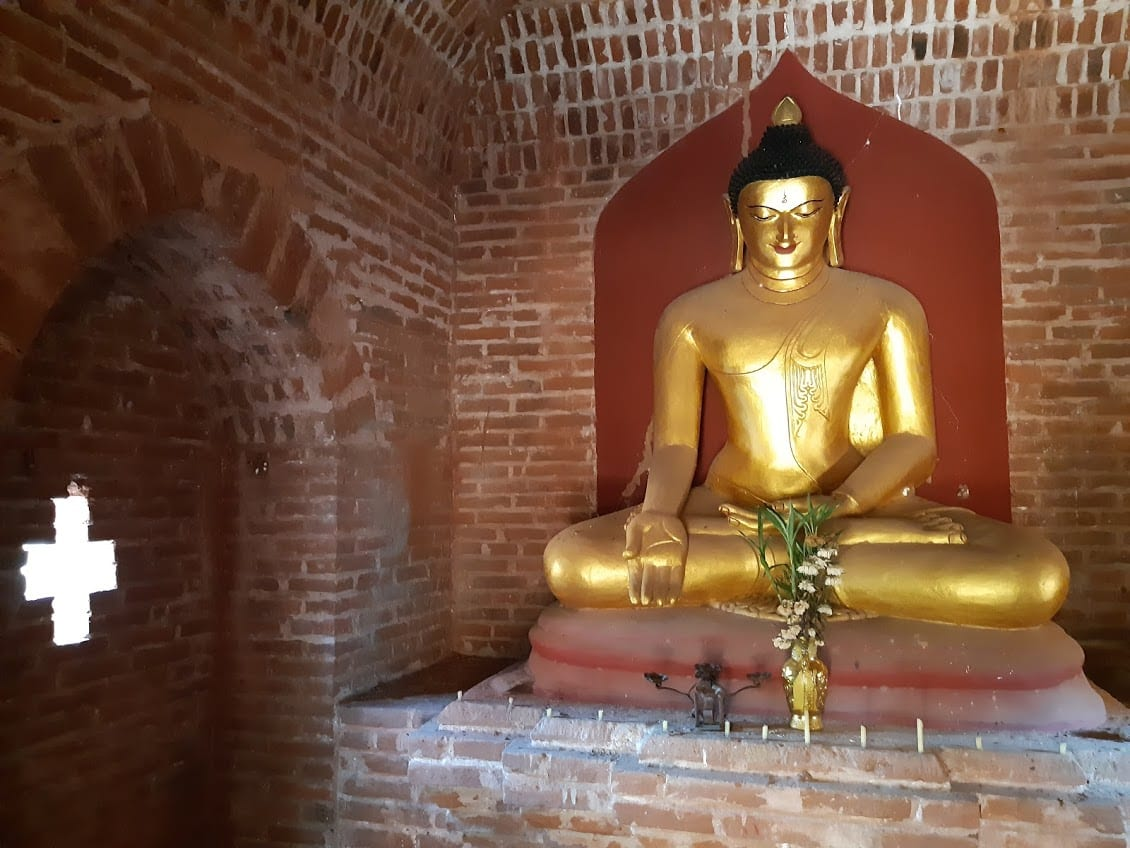A Buddha and the cross symbol in a pagoda in Bagan