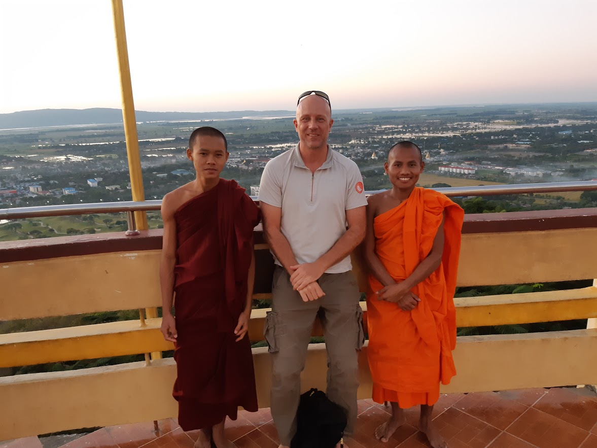 Chatting with Buddhist monks in a temple in Mandalay