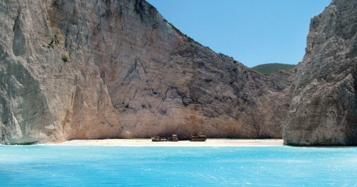 Early morning tour of the famous Shipwreck beach and Blue Caves in glass-bottom speedboat