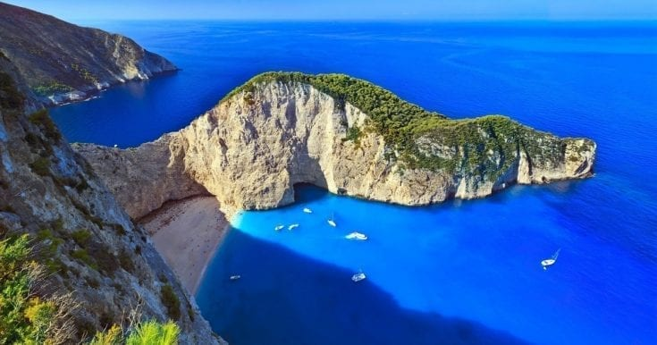 Visit the famous Shipwreck beach, Blue Caves and a winery