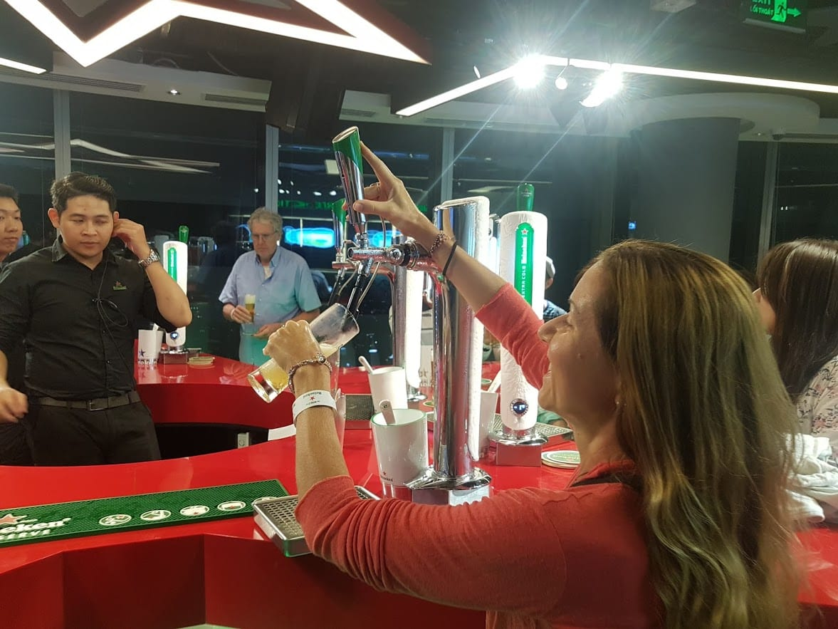 Vanessa pouring a pint in the Heineken Bar in Saigon