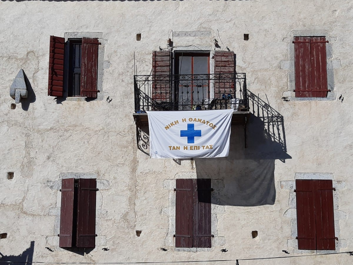 Greek revolution flag on siplay outside a house near Arepoli