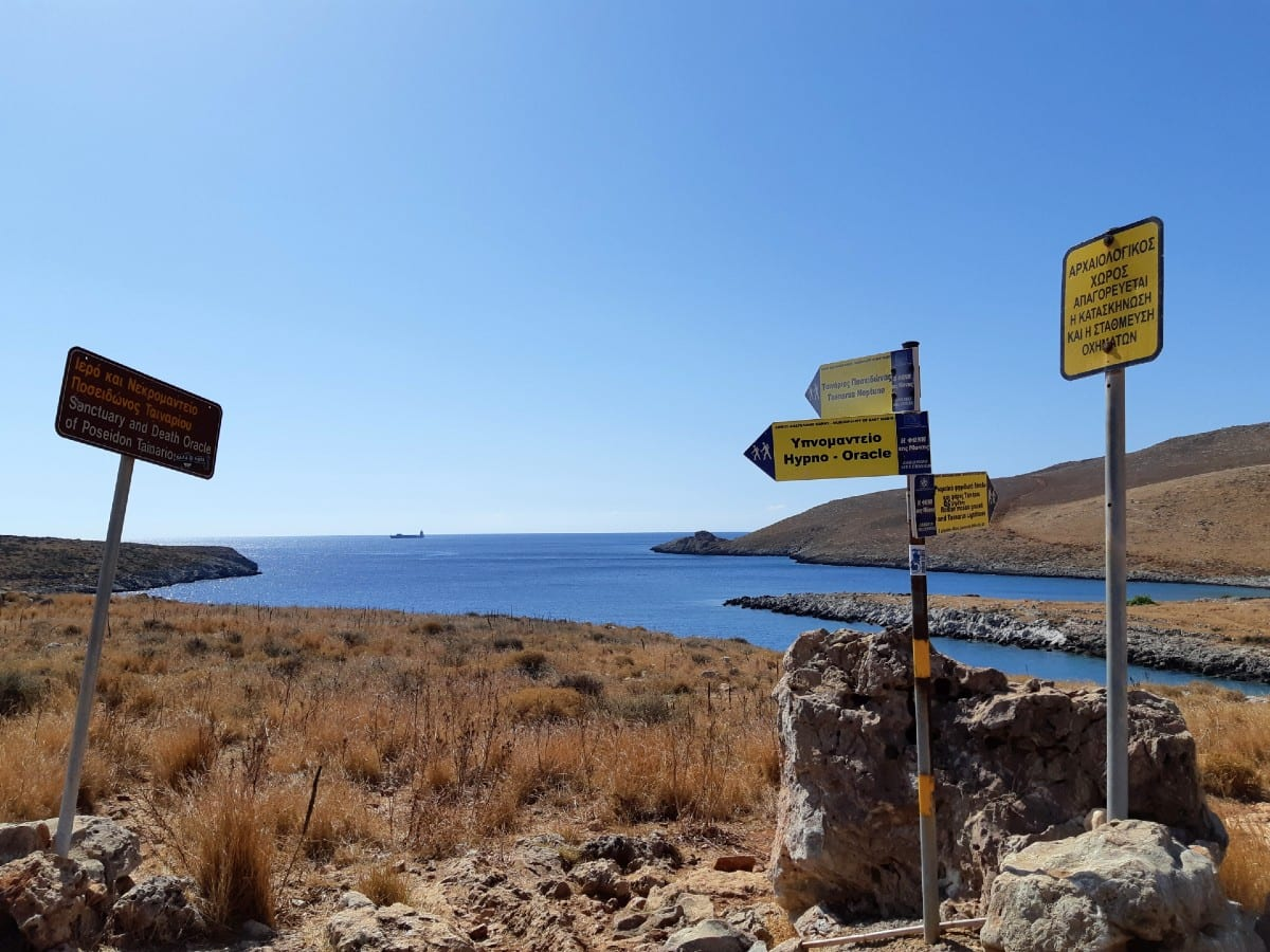 Clearly marked signs for the hiking path at Cape Tainaron in Greece