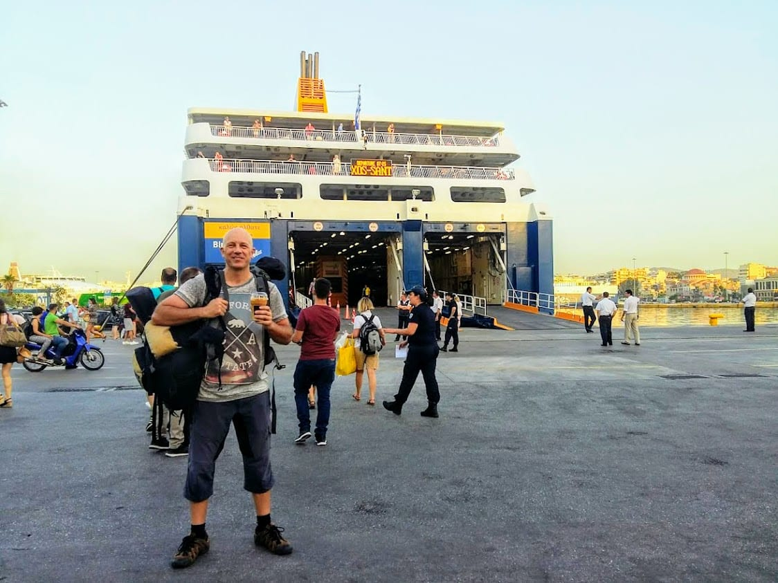 Dave Briggs in front of a ferry in Greece