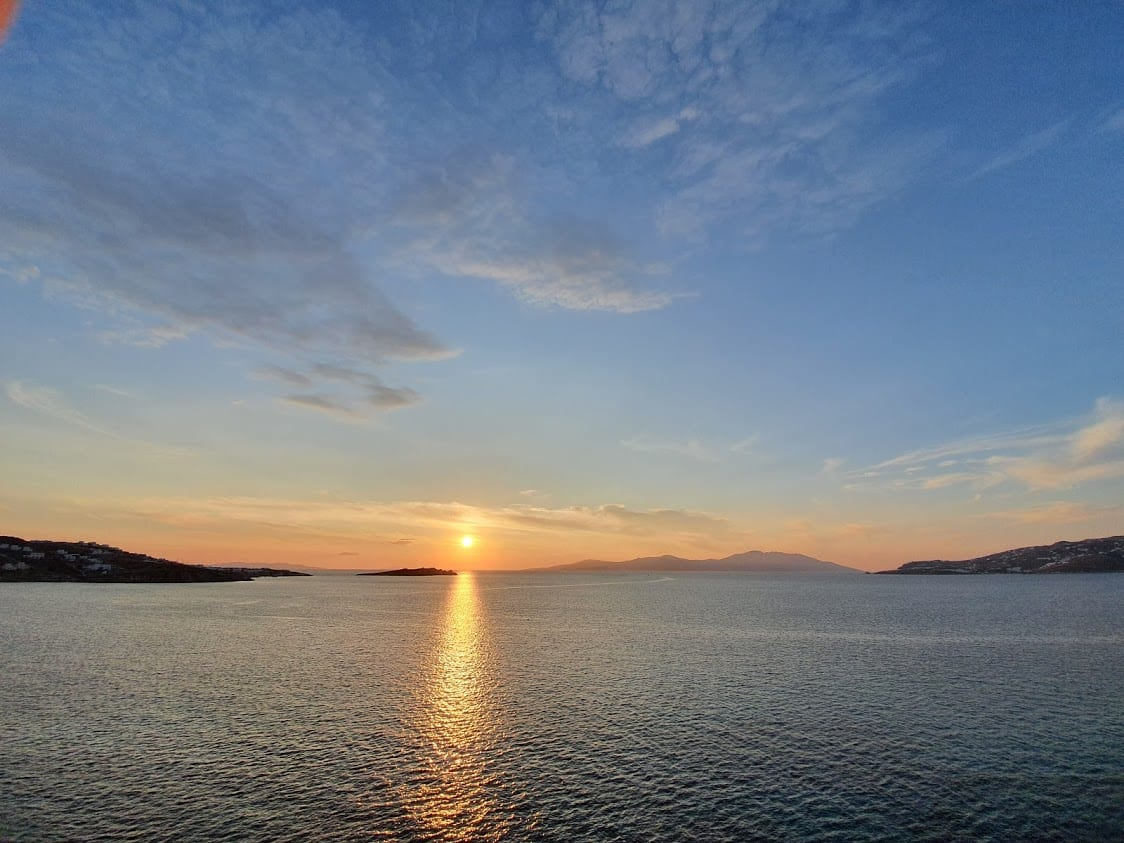 Sunset on a beach in mykonos