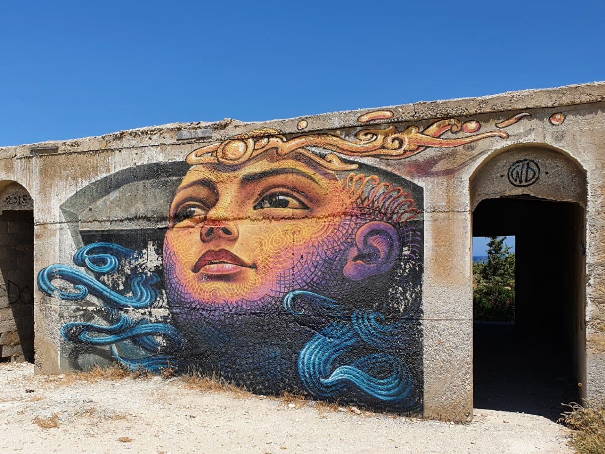 Street art at an abandoned hotel in Alyko, Naxos