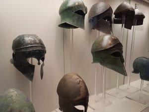 A collection of battle helmets from ancient Greece on display in Olympia