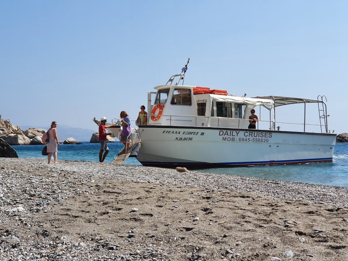Taking the water taxi to Katergo beach in Folegandros island Greece