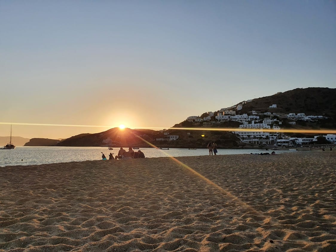 Enjoying the sunset on Mylopotas beach in Ios Greece