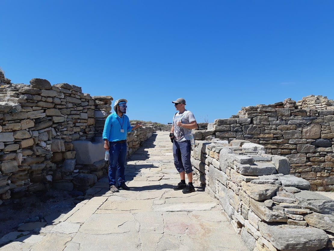 Dave from Dave's Travel Pages and a tour guide in Delos island in Greece