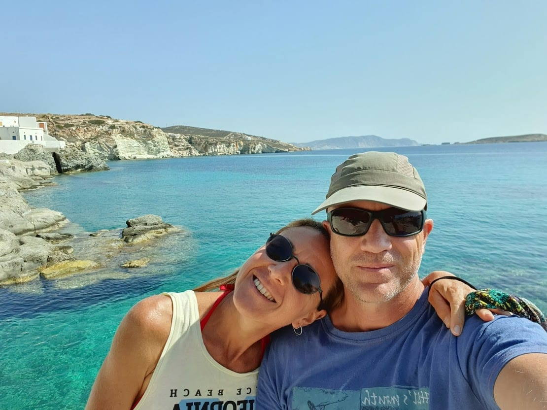 Dave and Vanessa by the clear sea at Goupa in Kimolos island Greece