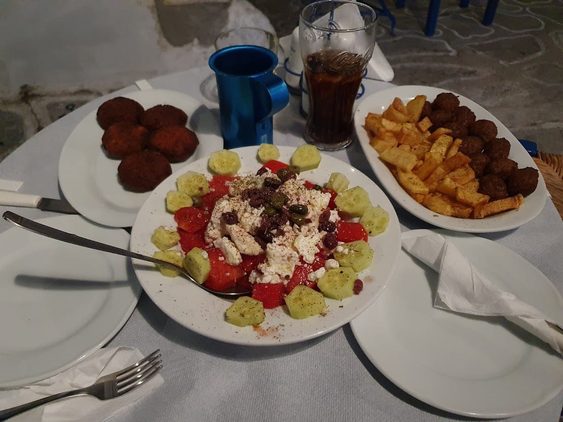 Eating a meal in a taverna in Kimolos