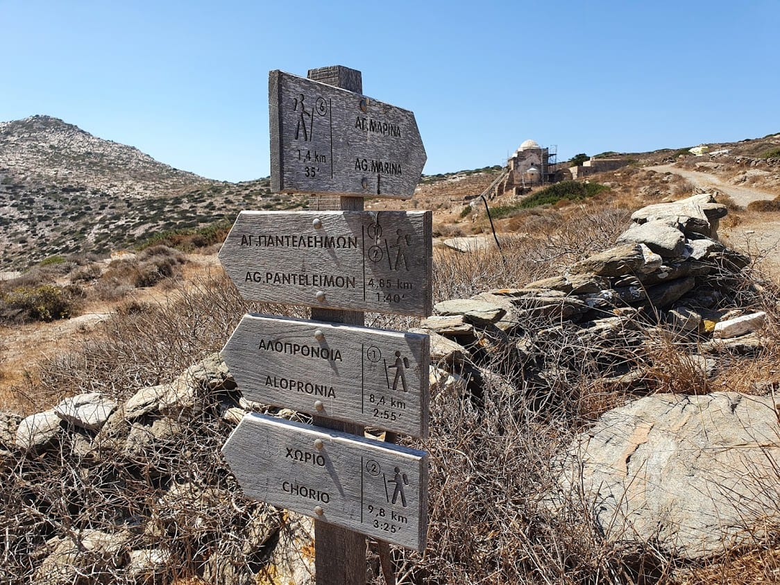 A signpost marking hiking trails in sikinos