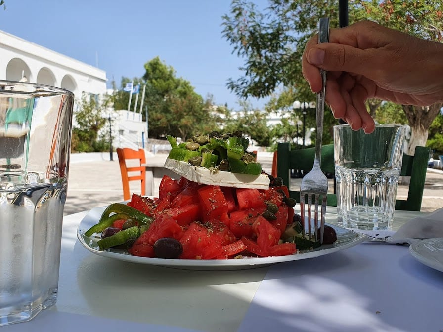 Eating a large Greek salad in Fatse taverna in Milos greece