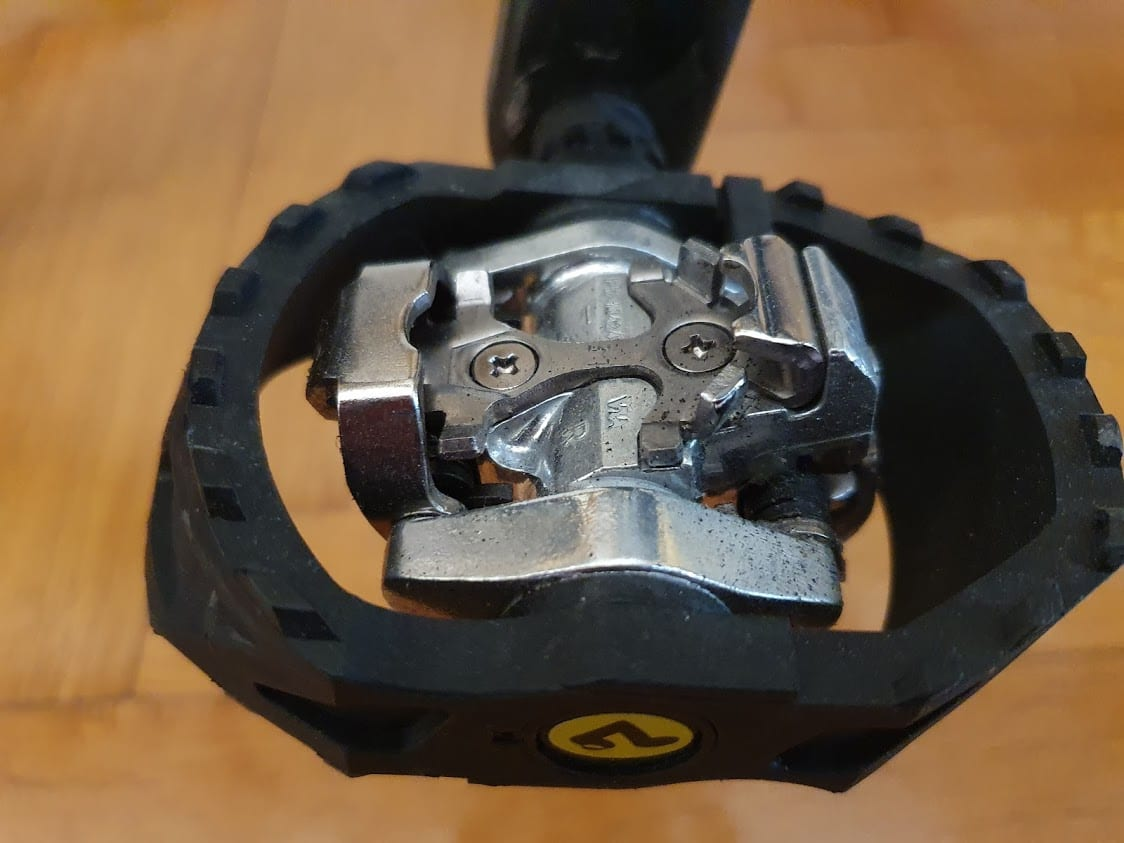 I use these Shimano SPD pedals for bicycle touring
