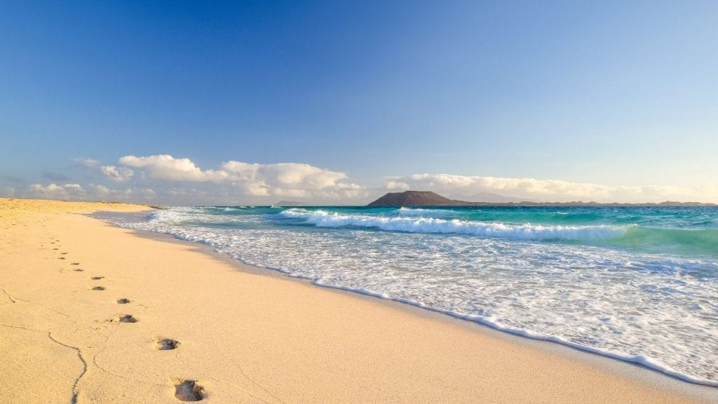 Enjoying the beach in the warm weather of the Canary islands in winter