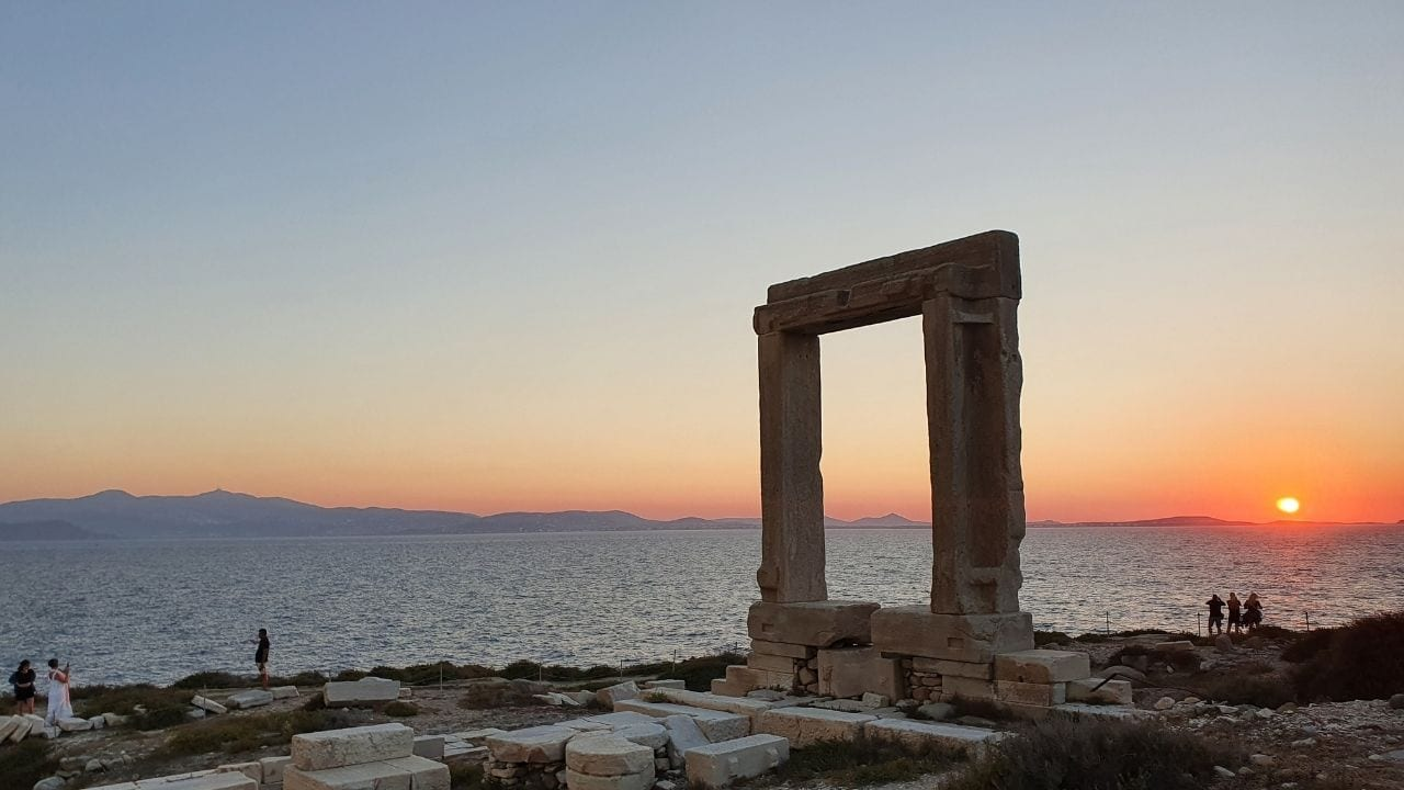 By staying in Chora in Naxos, you will be near the magnficent Portara as shone at sunset in this photo