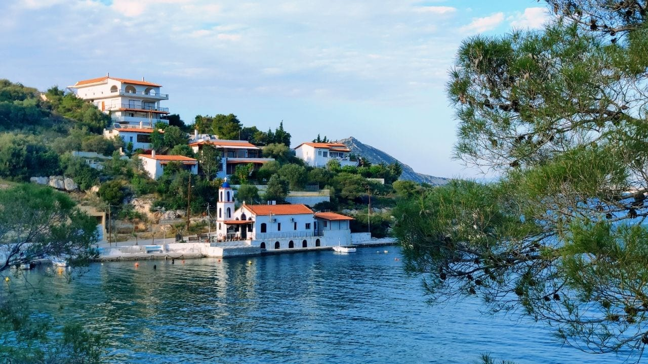 A view of a church over the water in Salamina island Greece