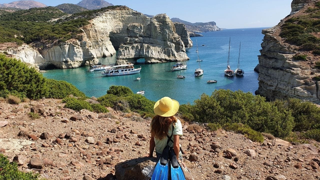 Yachts arriving in Kleftiko Bay in Milos Island Greece