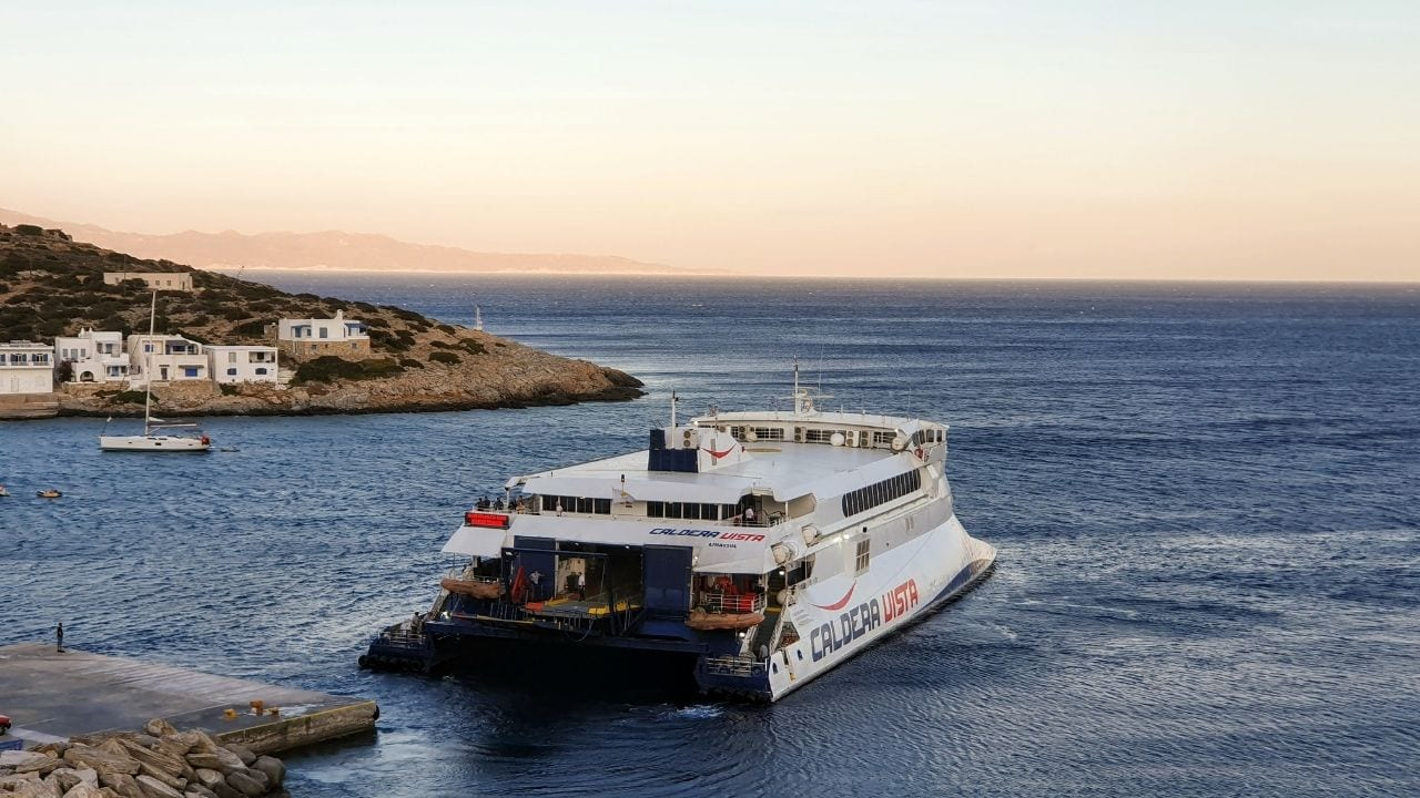 A ferry arriving at the small port in Sikinos island in Greece