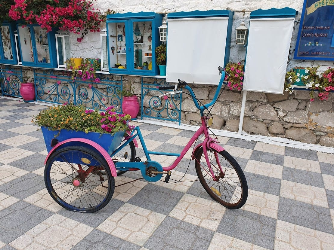 The well photographed pink bicycle in Adamantas Milos