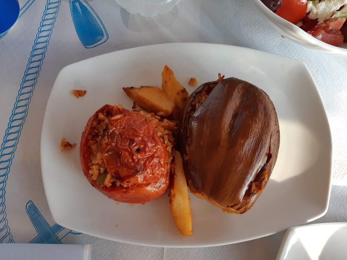 Eating stuffed tomatoes in the taverna on Kalamitsi Beach in Kimolos