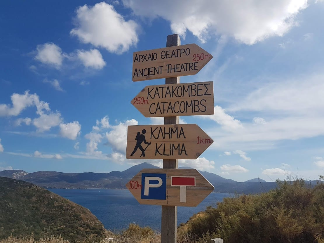 Signposts on a hiking trail in Milos