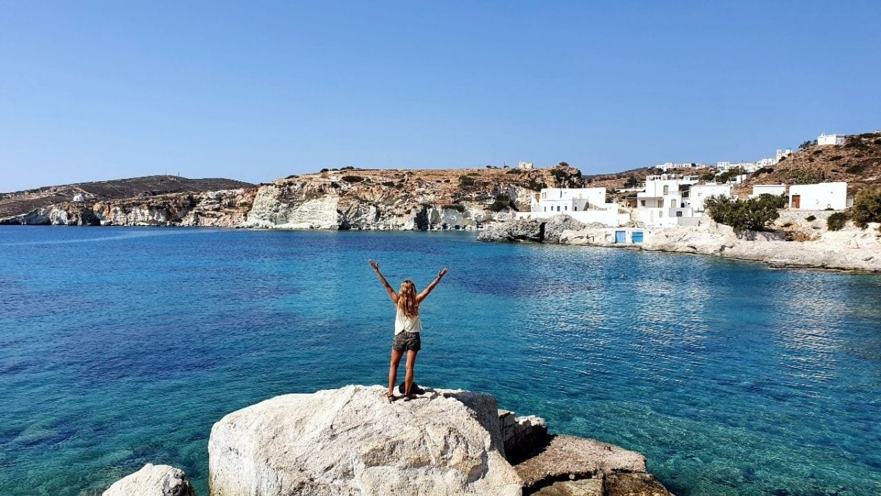 Standing on the rocks in front of Goupa village in Kimolos island