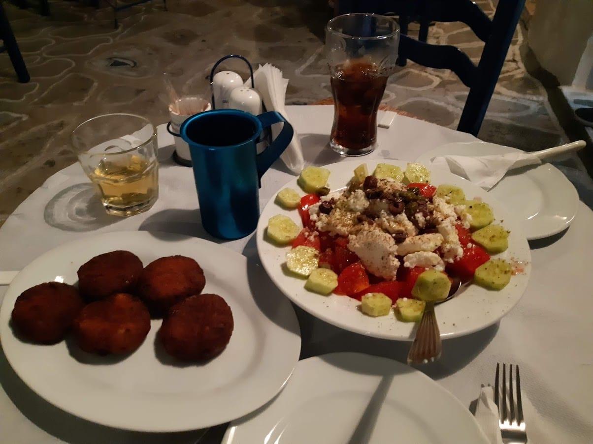 Delicious Greek food at a restaurant in Kimolos