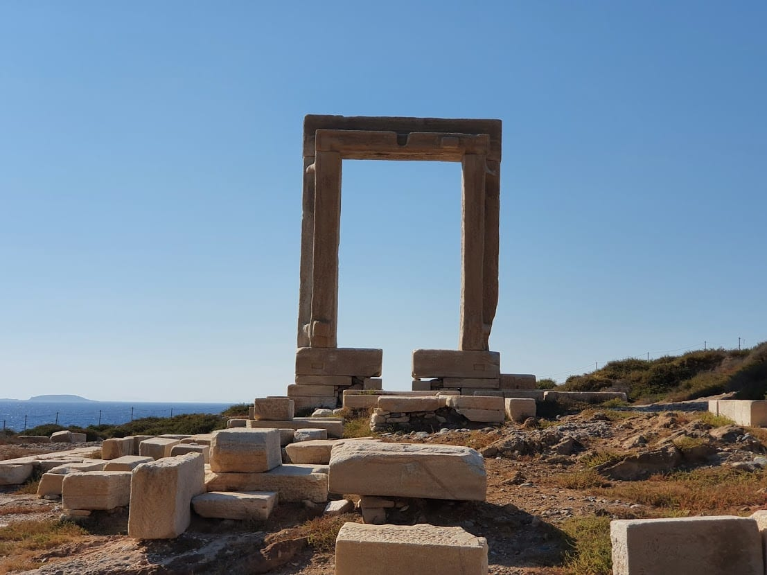 The Portara of Naxos along with some abaondoned stones from the temple