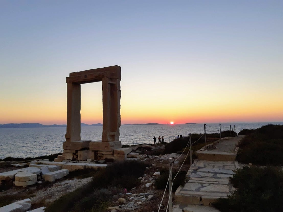 Enjoying the sunset at the Portara in Naxos island Greece